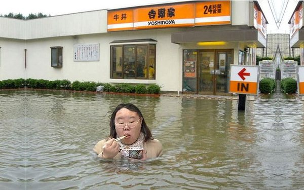 fat-asian-chick-eating-something-in-a-flood